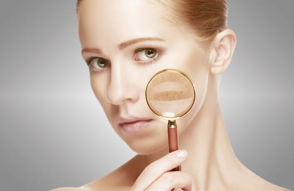 concept skincare. Skin of woman with magnifier